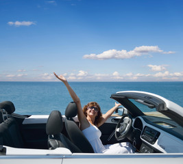 woman in a white convertible