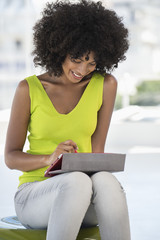 Smiling woman using a digital tablet