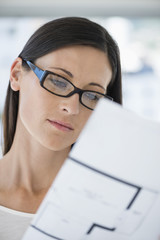 Close-up of a woman reading a document