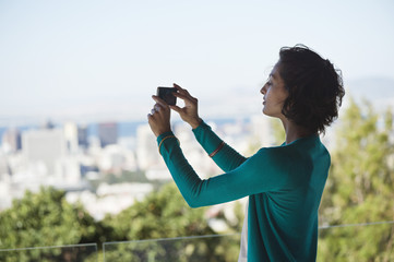 Woman photographing with a mobile phone