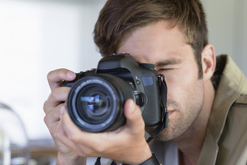 Close-up of a man photographing with a camera