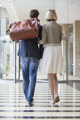 Couple walking at an airport