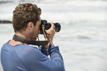Man photographing on the beach