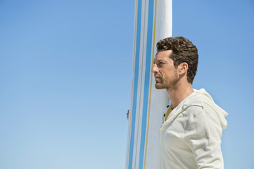 Man holding a surfboard