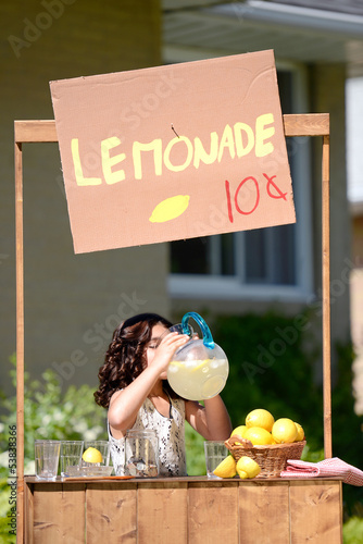 girl drinking lemonade from a pitcher