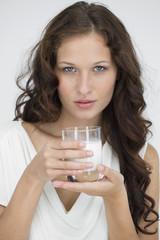 Portrait of a woman drinking milk