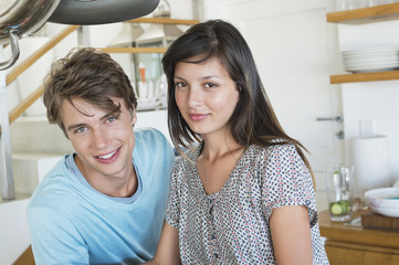 Portrait of a couple smiling in the kitchen