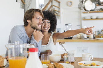 Smiling couple sitting at a dining table