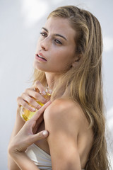 Woman spraying perfume on her body
