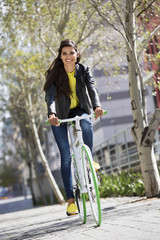 Portrait of a woman riding a bicycle and smiling