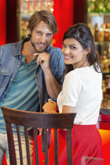 Portrait of a smiling couple at a restaurant
