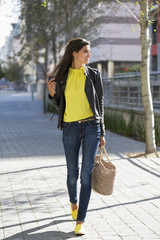 Woman walking with a handbag