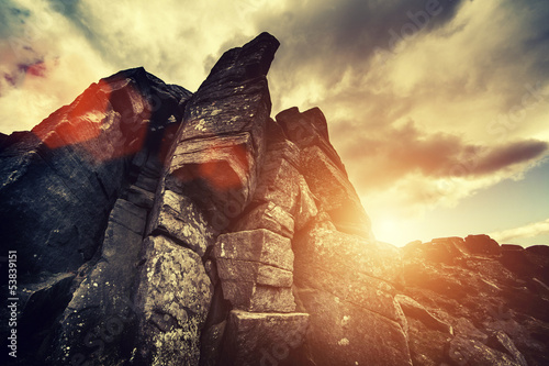 dramatic rock and sun