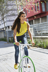 Woman riding a bicycle and smiling