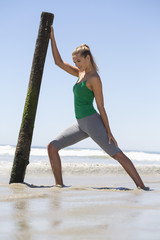 Woman exercising on the beach