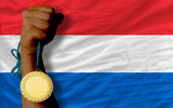 Gold medal for sport and  national flag of holland