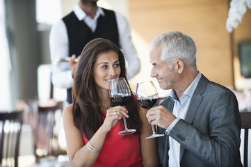 Couple enjoying red wine in a restaurant