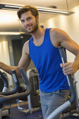 Portrait of a smiling man exercising in a gym