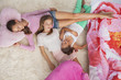 Girls sleeping on a carpet at a slumber party