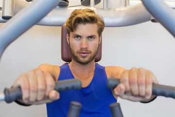 Portrait of a man exercising in a gym