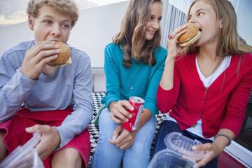 Friends enjoying fast food together