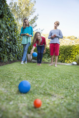 Friends playing Petanque in a garden