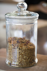 Granola in a jar at a kitchen counter