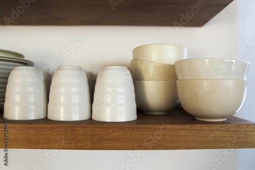 Bowls and glasses in a shelf