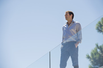 Man standing on the terrace with his hands in his pockets
