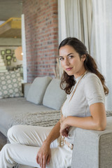 Portrait of a beautiful woman sitting on a couch