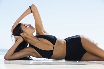 Beautiful woman in bikini posing on the beach