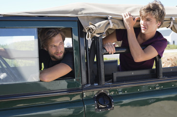 Two male friends in a SUV