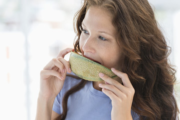 Close-up of a woman eating melon