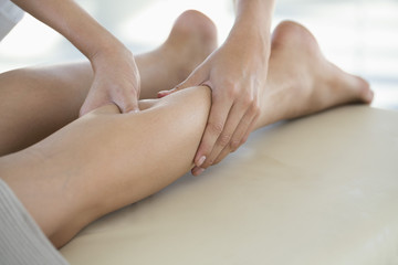 Woman receiving leg massage from a massage therapist