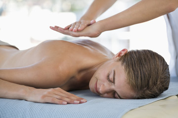 Woman receiving back massage from a massage therapist