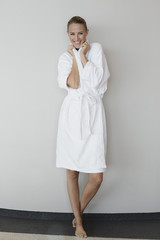 Portrait of a smiling woman in bathrobe at spa