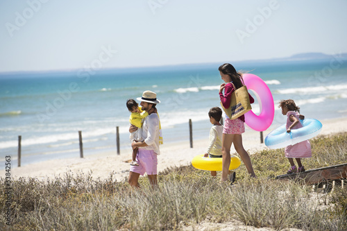 Family walking on a boardwalk on the beach