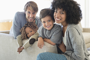 Portrait of a couple smiling with their children