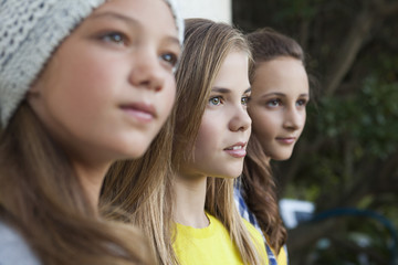 Close-up of three girls staring