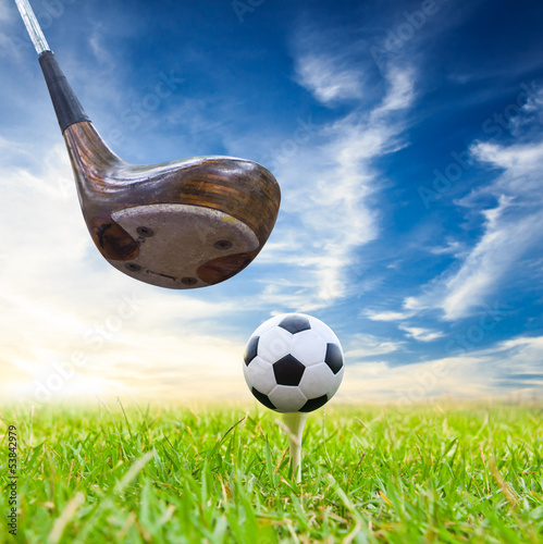 driver hit soccer ball on tee