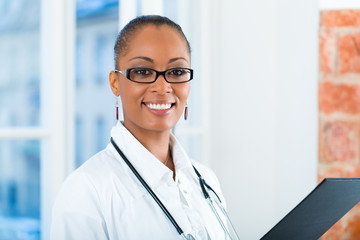 Portrait of young female doctor in clinic