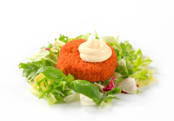 Fried cheese or fish with green salad