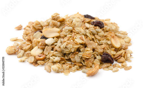 Pile of granola cereal with raisins and nuts