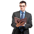 Businessman reading his agenda isolated on white