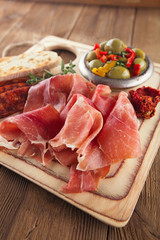 Platter of serrano jamon Cured Meat, Ciabatta, chorizo and olive