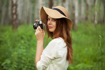 Beautiful girl with a camera