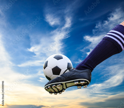 foot kicking soccer ball