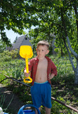 Young boy with his spade in the garden
