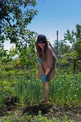 Woman weeding the vegetable garden