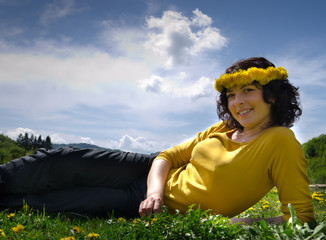 A young woman smiling wearing a yellow top